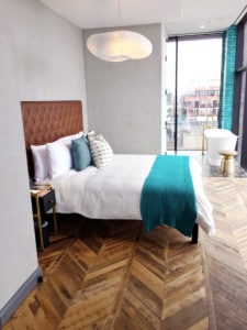 Reclaimed Oak Flooring Skip-Planed Chevron in Williamsburg Hotel Guest Suite Bedroom